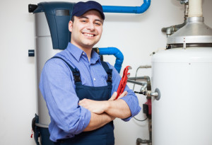 Technician servicing an hot-water heater